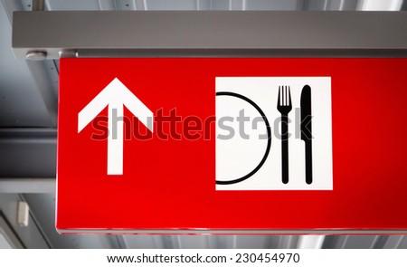 Restaurant direction sign - stock photo
