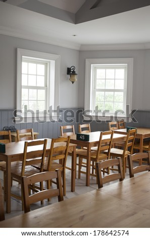 restaurant, empty wood table set decorated in restaurant dining room