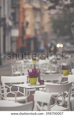 Restaurant exterior with table and chairs at the town street