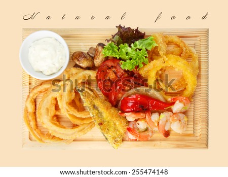 Restaurant food - roasted seafood with grilled vegetables assortment served on wooden board isolated at the white background - stock photo