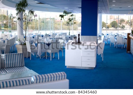 Restaurant interior with blue and white colour scheme - stock photo