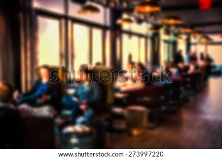Restaurant lounge blur with people relaxing