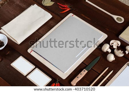 Restaurant menu and utensil on the wooden table, top view