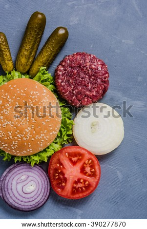 Restaurant menu, burgers ingredients. View from above on slate, with copy space border background. - stock photo