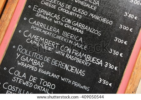 Restaurant menu in Spanish - outdoor bar in Seville, Spain - stock photo