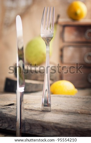 Restaurant menu series. Country place setting. Fork and knife in rustic country table setting. setting - stock photo