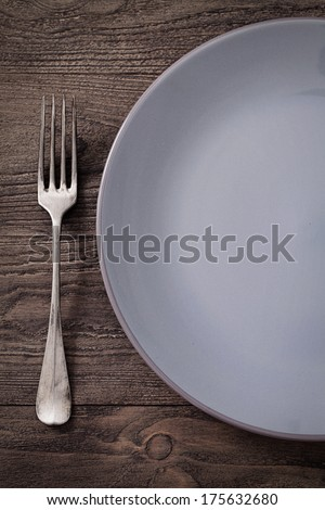 Restaurant Menu series with copyspace. Fork in rustic table setting - stock photo