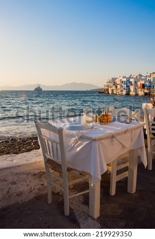 Restaurant near the sea at Little Venice on the island of Mykonos in Greece at sunset - stock photo