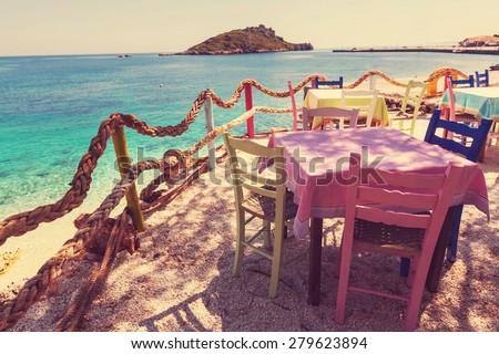 Restaurant on Greece coast - stock photo