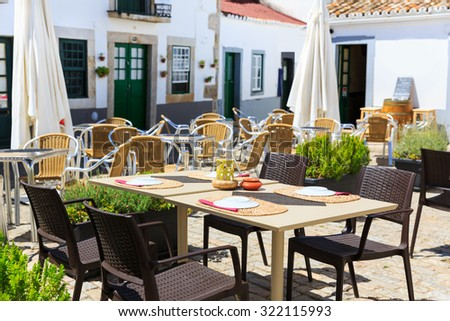 Restaurant outdoor with served table on the street, Portugal, Madeira