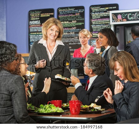 Restaurant owner with group of unhappy customers - stock photo