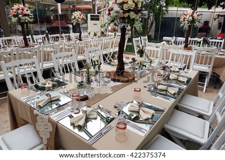 Restaurant.Restaurant decorated with plates, cutlery, glasses, flowers, knives and various decoration materials. - stock photo