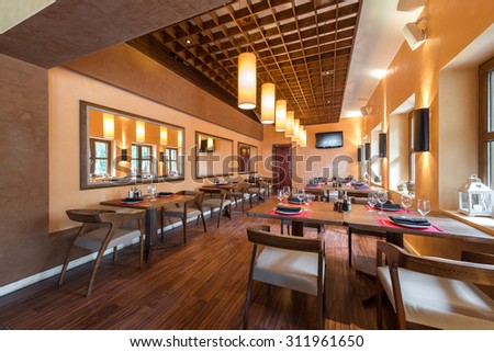 Restaurant room with wooden furniture - stock photo