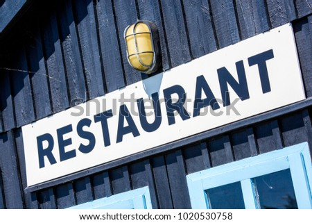 Restaurant sign on blue background