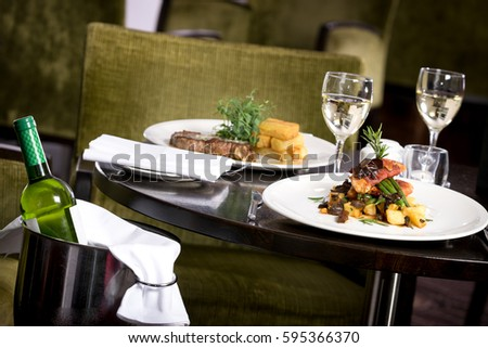 Restaurant table set for two main dish steak fish cuisine fine dinning white wine glass bottle : a table set for two - pezcame.com