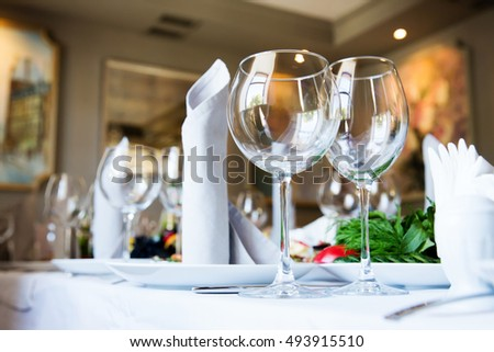 Restaurant table with glasses and napkins