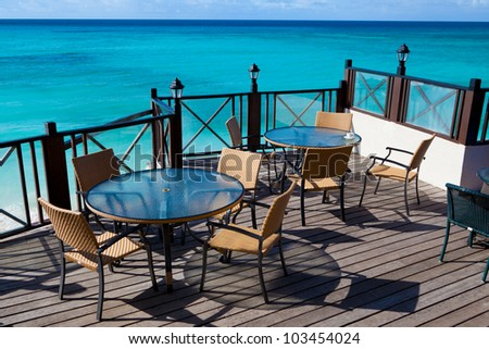 restaurant tables with a sea view - stock photo