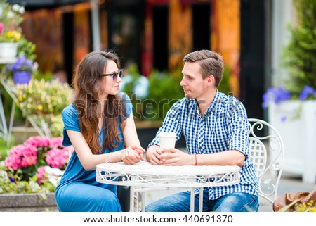 Restaurant tourists eating at outdoor cafe. Young friends enjoy time together in summer day. - stock photo