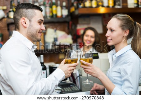 Restaurant visitors waiting for table and drinking wine at bar