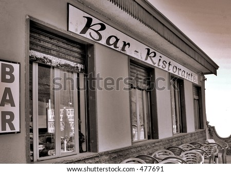 Restaurant with reflection of Mt. Etna - stock photo