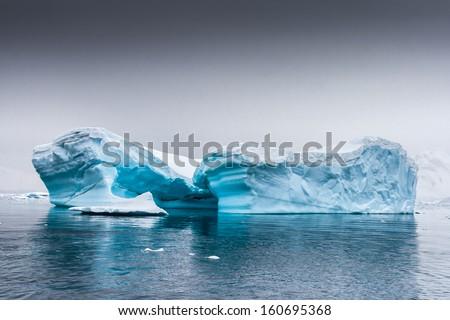 Restful iceberg near Almirante Brown, Antarctica - stock photo