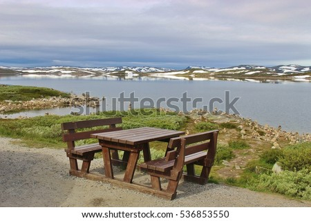 Resting Area on the Hardanger mountains plateau, in Norway, Europe. In August, there is still snow on the mountains. Height above sea level approx. 1100 meters.