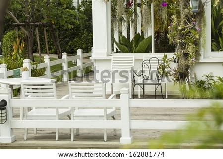 resting area, white bench on balcony rest garden area - stock photo