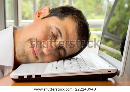 resting at the workplace by the overwork  - stock photo