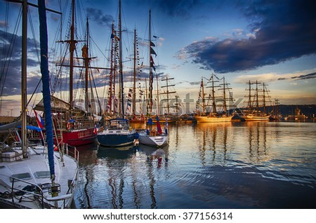 Resting boats at the harbour of Varna at sunset - stock photo