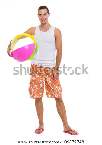 Resting on vacation smiling young man with beach ball - stock photo