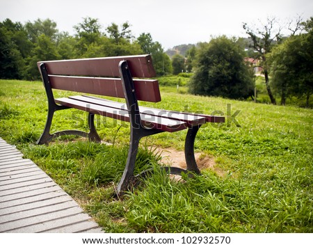 Resting place in a park with trees background
