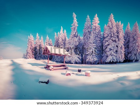 Resting place with alcove in the snowy mountain forest in sunny morning. Instagram toning - stock photo