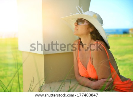 Resting woman. Beach hotel, the sea