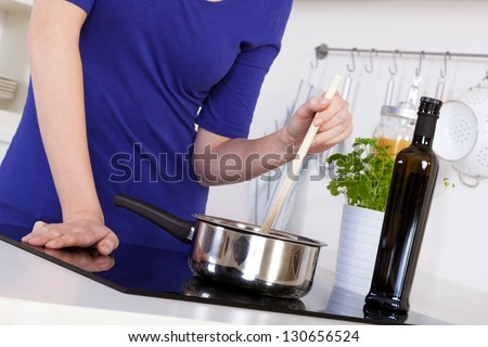 resting your palm on an induction stove is secure and will cause no burns - stock photo