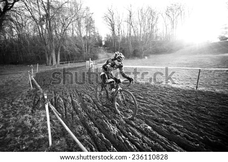 RESTON, VIRGINIA - DECEMBER 7: A cyclist braves the mud in the elite men's event of  the Capital 'Cross Classic cyclocross competition on December 7, 2014 in Reston, Virginia - stock photo