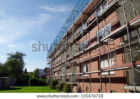 Restoration of house with scaffold - stock photo
