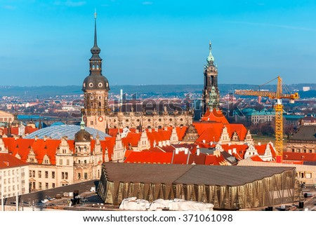 Restoration work in the center of the Old Town in Dresden, building site, crane on the background Royal Palace and Hofkirche, Saxony, Germany - stock photo