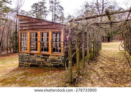 restored historic wood house in the uwharrie mountains forest - stock photo