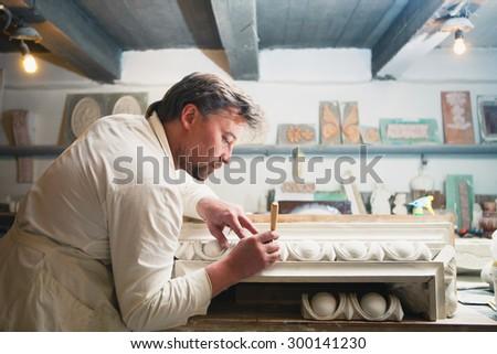 restorer making his work at workshop - stock photo