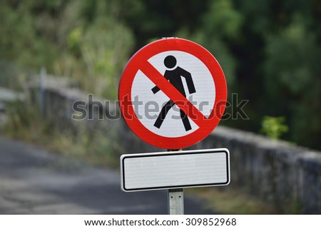 Restricted area. Pedestrians prohibition. Real sign NO PEDESTRIAN