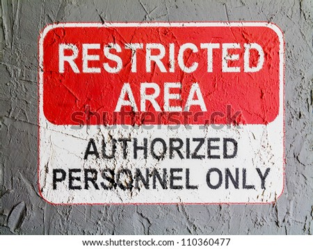 Restricted area sign painted on wall