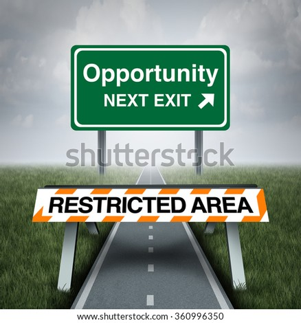 Restricted opportunity concept and business road block symbol as a barrier with text barring entrance to a road with a sign for opportunities as a metaphor for discrimination or unfair limited world. - stock photo