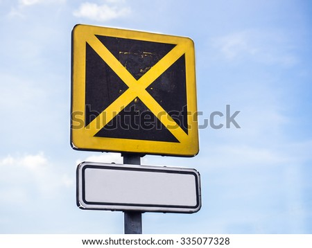 Restricted stop sign on blue sky - stock photo