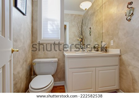 Restroom interior with grey walls. Refreshing white vanity cabinet with mirror