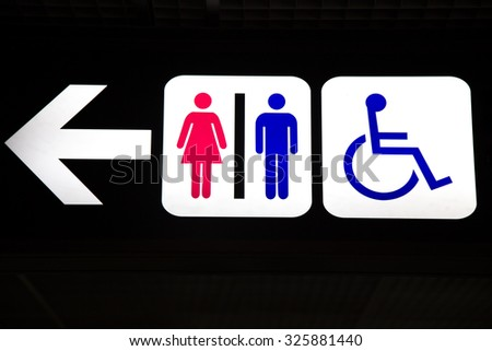 Restroom male, female and cripple public sing  bathroom Signs sign toilet Men and women toilet sign with an arrow showing direction - stock photo