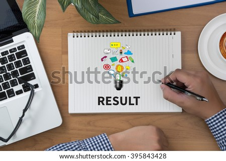 RESULT Concept ,man hand notebook and other office equipment such as computer keyboard, digital tablet, pencil, - stock photo
