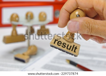 result marked on rubber stamp