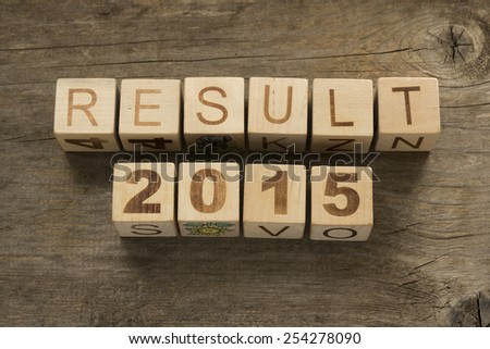 Result 2015 on a wooden background - stock photo