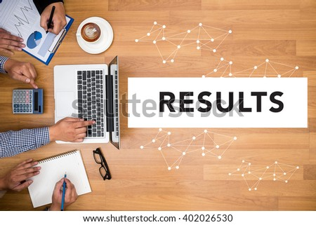 RESULTS  Concept Business team hands at work with financial reports and a laptop - stock photo