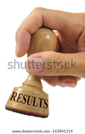 results marked on rubber stamp - stock photo